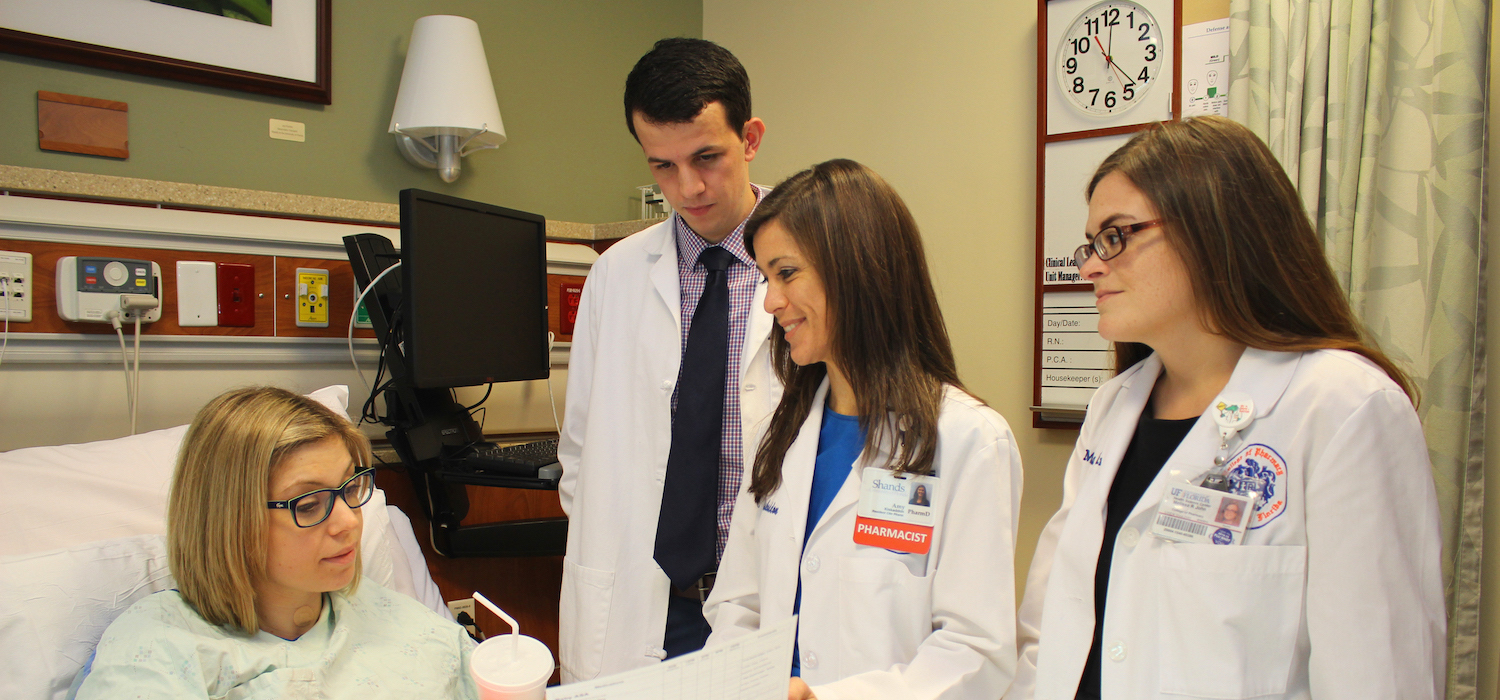 Student pharmacists treat a mock patient